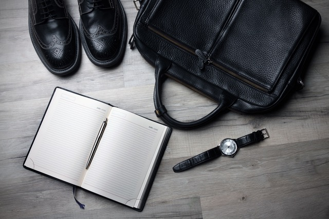 Black shoes, bag, watch and notepad